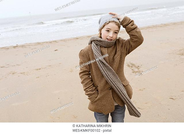 Portrait of boy standing on the beach in winter