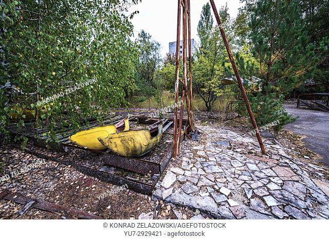 Broken swingboat in amusement park of Pripyat ghost city, Chernobyl Nuclear Power Plant Zone of Alienation around nuclear reactor disaster in Ukraine