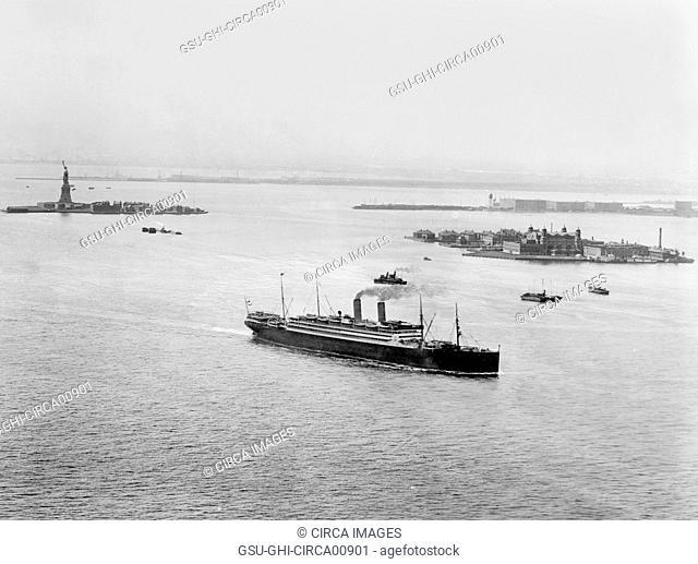 Statue of Liberty, Ellis Island and Ship in Harbor, New York City, USA, circa 1910