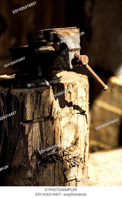 Metalworking hand tool on a tree stump