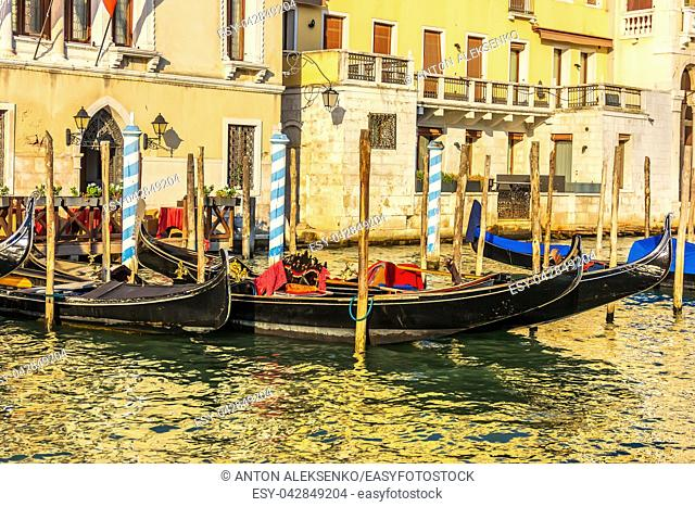 Gondolas moored on the Grand Canal of Venice, Italy