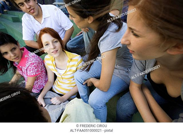 Teenage girl hanging out with group of friends