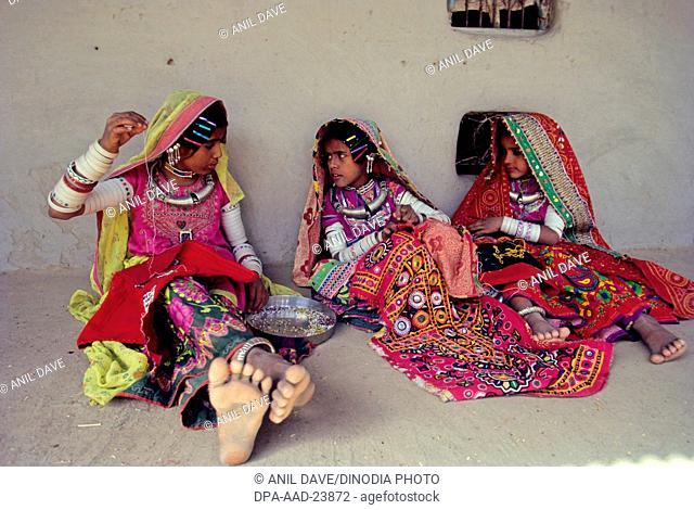 Woman Busy with embroidery work , Kutch , Gujarat , india