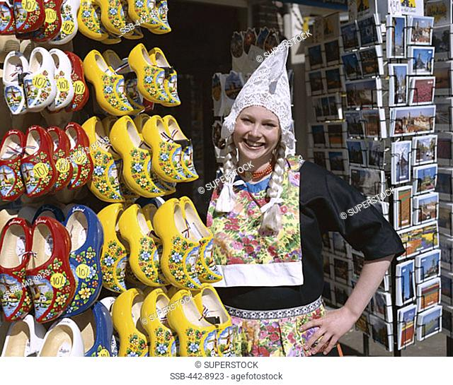 Girl Dressed in Dutch Costume, Souvenir Store Selling Clogs and Postcards, Amsterdam, Netherlands