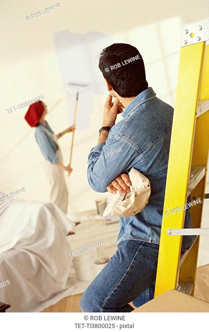 Couple painting home