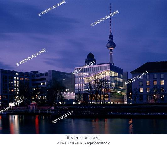 Netherlands Embassy, Berlin. Exterior nightshot across River Spree with Alexanderplatz Fernsehturm, TV tower in background