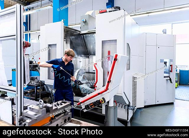 Man working on a machine in a factory