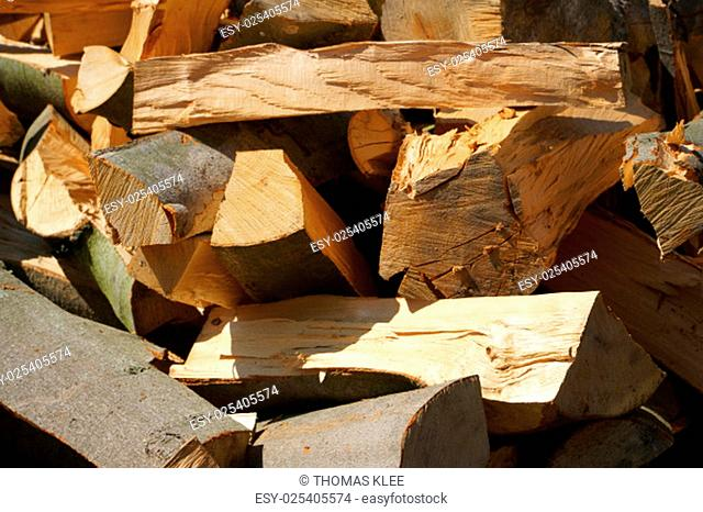 Detail of dry firewood logs in a pile