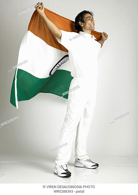 Indian cricket player holding flag of India on his backside MR702A