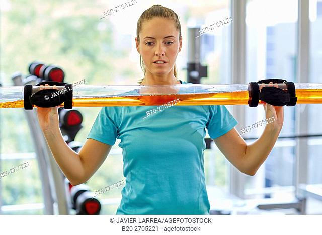 Woman, Muscle training with the slash pipe