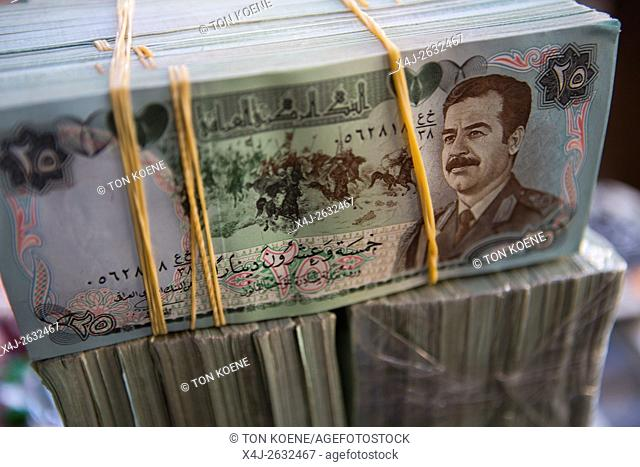 old bank notes of Saddam Hussein in Iraq