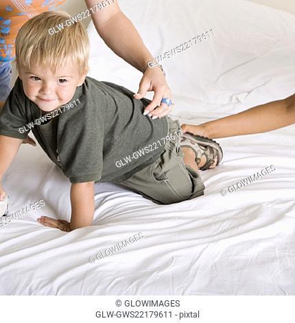 Boy crawling on a bed