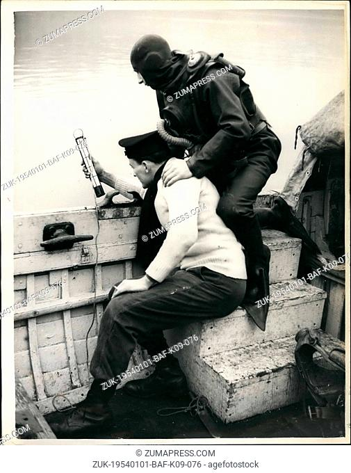 Jan. 01, 1954 - Naval Diving Exercises in the Thames.: Royal Navy divers began training in the river Thames, near the Houses of Parliament yesterday