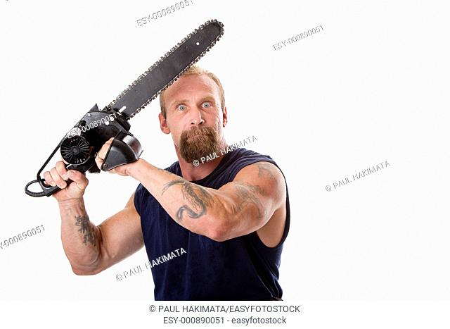 Crazy Caucasian man with tattoos and chainsaw above his head with strong expression in eyes, isolated