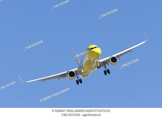 A Jet airplane on final approach to land at San Diego Airport