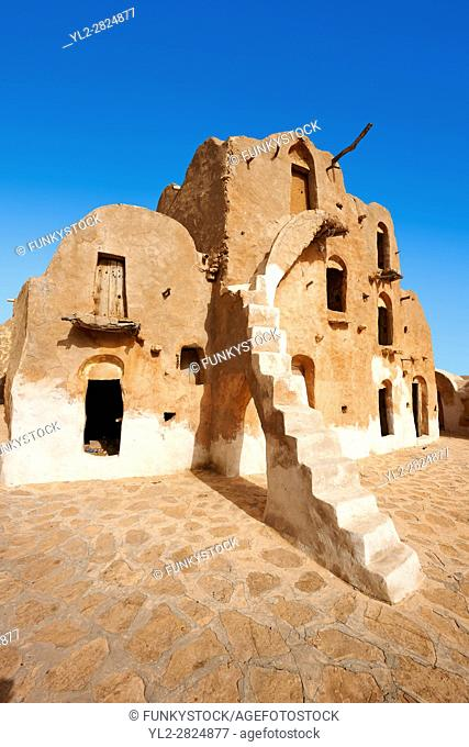 Ksar Ouled Soltane, a traditional Berber and Arab fortified adobe vaulted granary cellars, or ghorfas, situated on the edge of the northern Sahara in the...