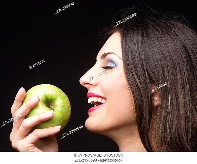 Young Brunette Woman Holding A Green Apple