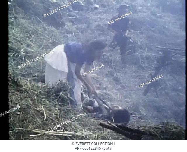 Woman trying to revive a dead soldier