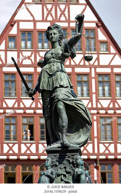 Statue on top of the Fountain of justice, Roemerberg, Frankfurt, Hesse, Germany
