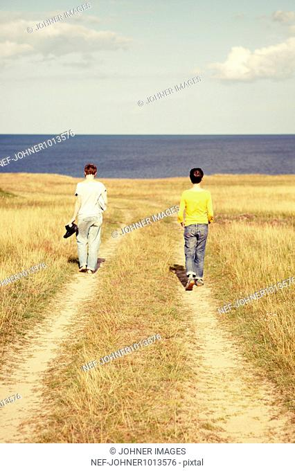 Women walking towards sea