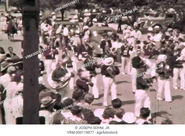Gallup New Mexico in the 1930's hosts Indian parade with Zuni's, Hopi's, Navajo, covered wagnons, horses, Native Americans, etc