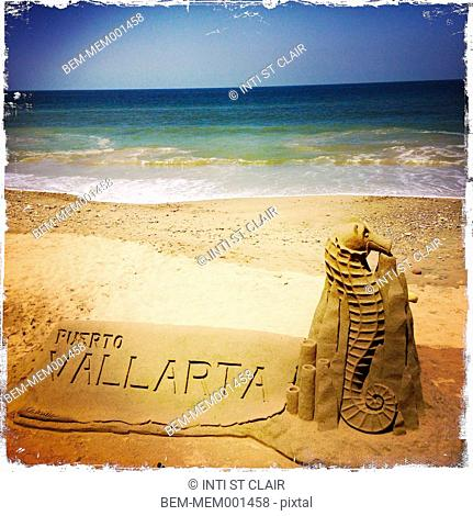 Puerto Vallarta in sandcastle on tropical beach
