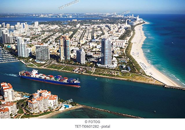 Aerial view of waterfront city and cargo ship