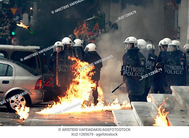 Protesters clash with the riot police, throw petrol bombs and stone against them  General strike in Greece as unions protest new labor reforms amid persisting...