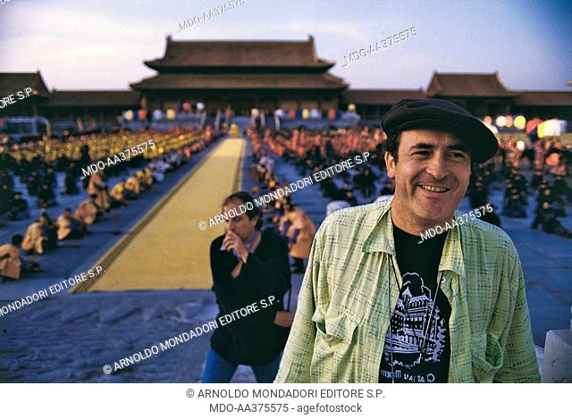 Bernardo Bertolucci on the set of the film The Last Emperor. Italian director and scenarist Bernardo Bertolucci smiling on the set of the film The Last Emperor