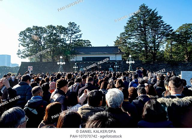 Japan: Crowds at the main gate of Tokyo Imperial Palace. On the occasion of the last birthday speech of Japan's Emperor Akihito..Photo from 23