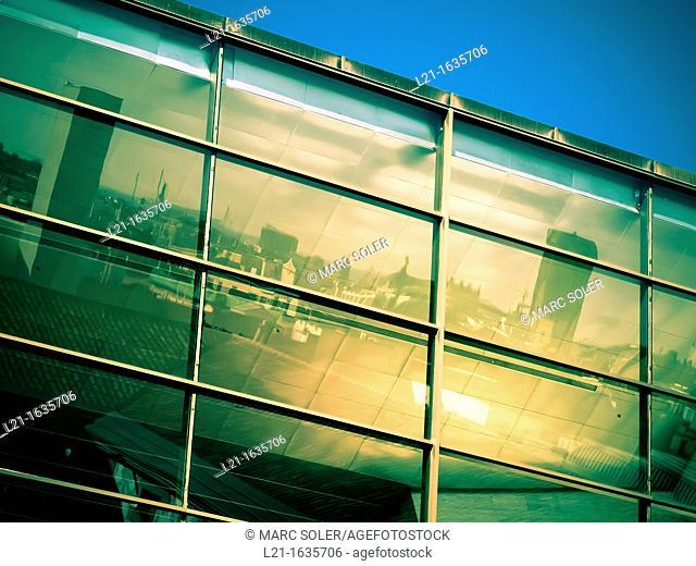 Barcelona skyline reflected on the windows of a building, Barcelona, Catalonia, Spain
