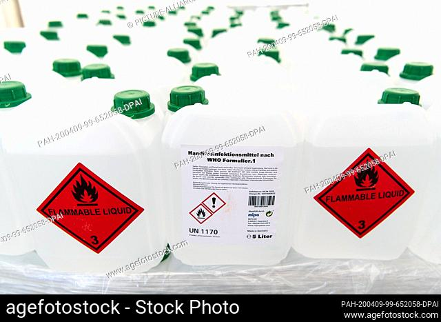 09 April 2020, Bavaria, Munich: Numerous canisters with hand disinfectant are standing in a tent city for disinfectant on pallets