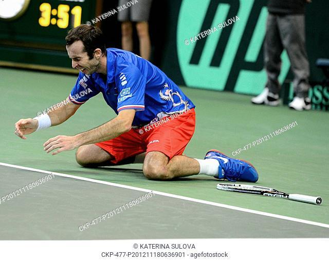 Radek Stepanek of Czech Republic throws his tennis racquet in celebration after he won his Davis Cup finals tennis singles match against Spain's Nicolas Almagro...