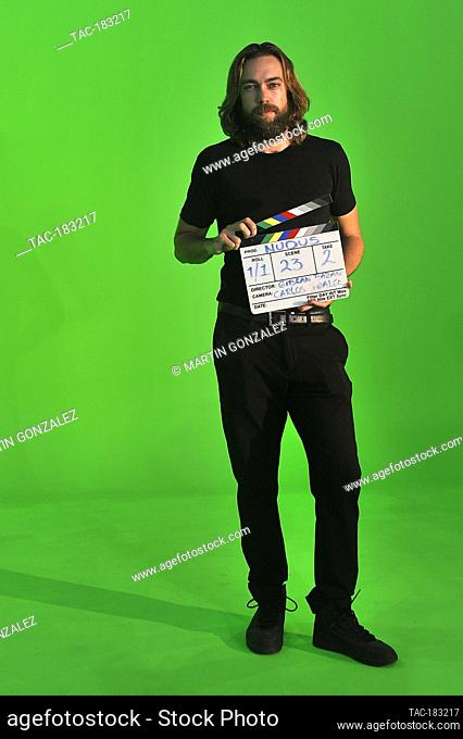 MEXICO CITY, MEXICO - OCTOBER 26: The actor, Alex Crusa poses with the Clapperboard from the film (Nudus) by director Gibran Bazanon October 26