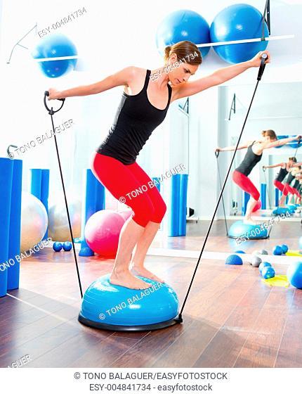 Bosu ball for fitness instructor woman in aerobics gym
