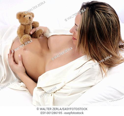 pregnant with bear in bed on a white background