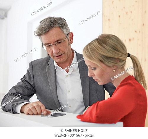 Mature manager working together with young collegue