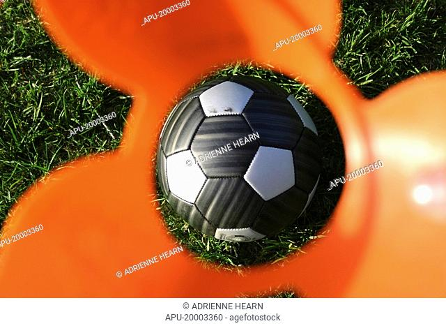 Football viewed through eye of a practise cone