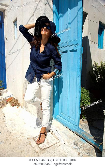 Woman at the entrance of a house door, Amorgos, Cyclades Islands, Greek Islands, Greece, Europe