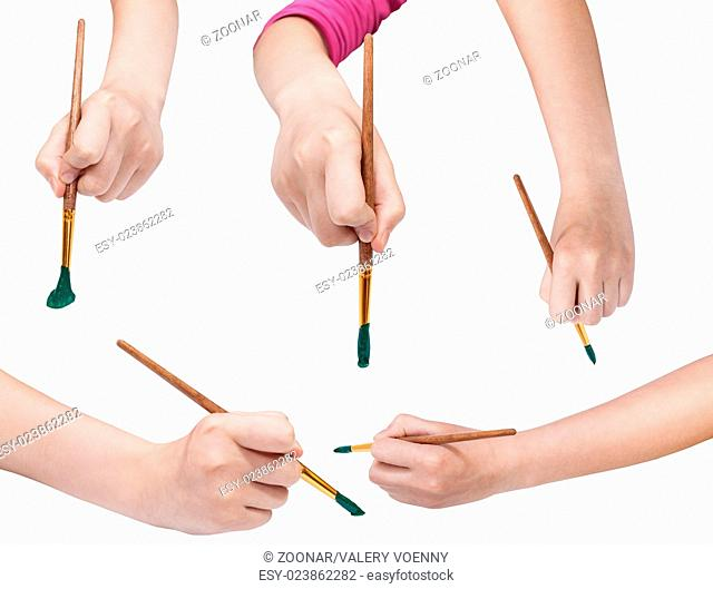 set of hands with art paintbrushes with green tips