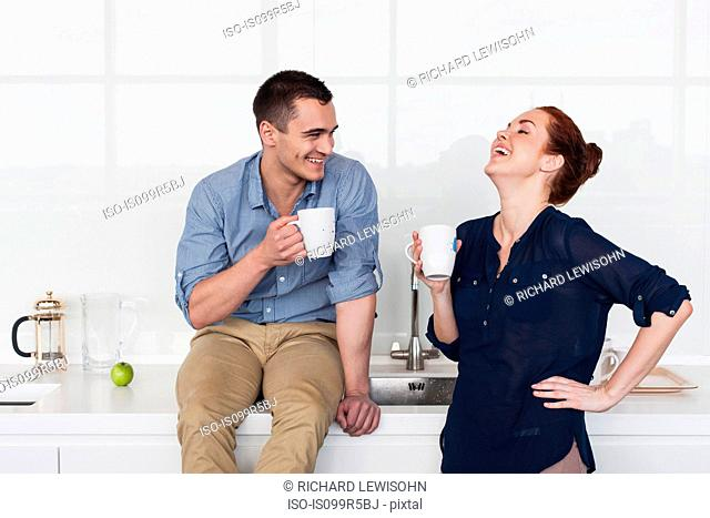 Colleagues laughing in kitchen