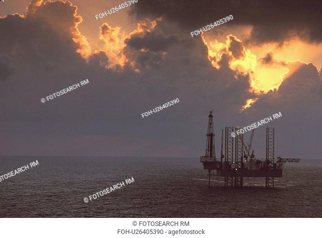 Silhouete of Offshore Oil Drilling Rig at Sunset