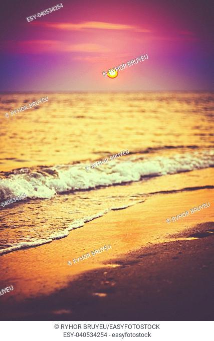Sea Ocean Waves Wash Over Golden Sand Background. Sunset, Sunrise, Sun. Close Focus Waves