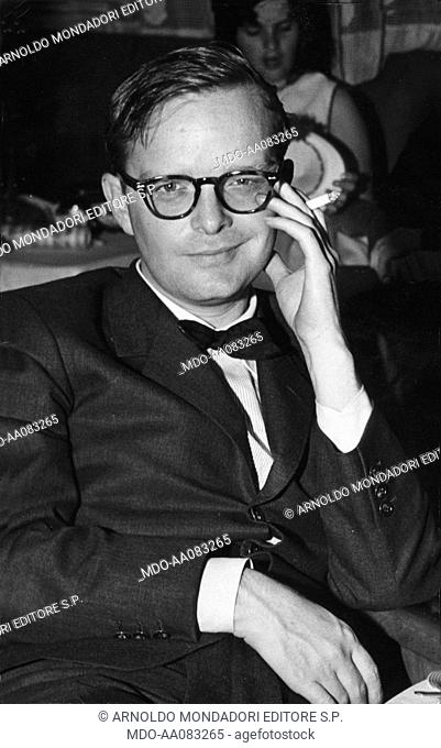 Truman Capote sitting in the restaurant of the M/S Vulcania. American writer and journalist Truman Capote sitting in the dining area of the M/S 'Vulcania'...