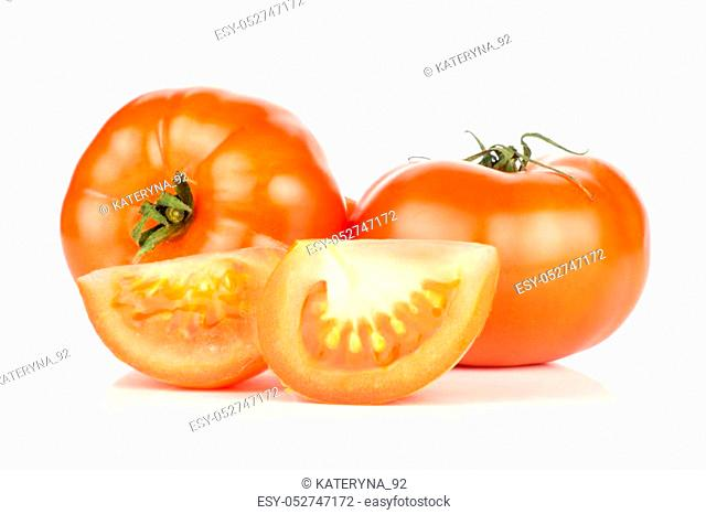 Two red tomatoes and two slices isolated on white background fresh