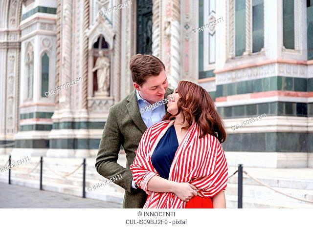 Young couple hugging, Santa Maria del Fiore, Florence, Toscana, Italy