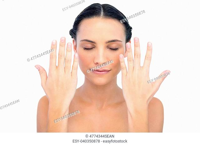 Pensive natural model raising hands on white background