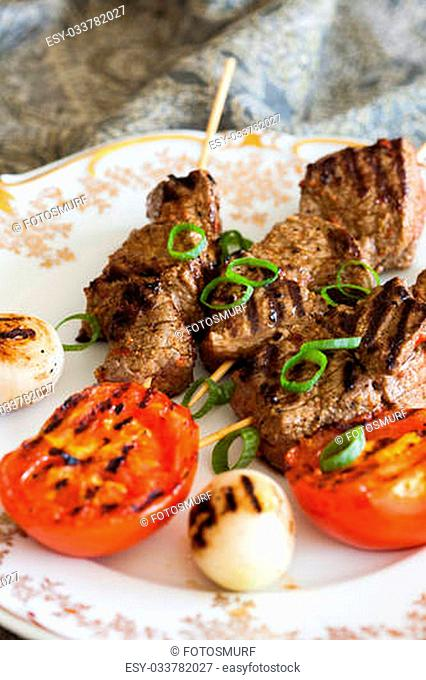 Moroccon style dish with beef on skewers