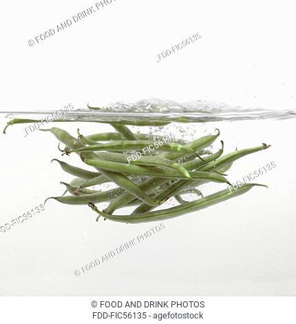 Green Beans splashing into water
