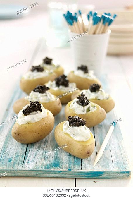 New potatoes filled with tzatziki and tapenade